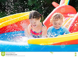kids playing in inflatable swimming pool stock photo image 74613038