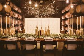 wine bottle wedding centerpieces diy gold wine bottle candlesticks centerpieces