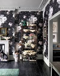 a dark floral jewel box of a powder room with dramatic over sized