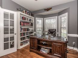 traditional home office with chair rail u0026 built in bookshelf in