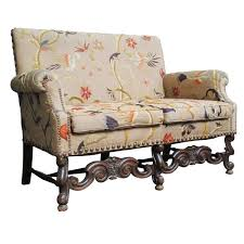 jacobean style settee with vintage upholstery traditional