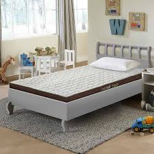 twin daybed mattress cover with wall hangings and table also