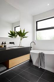 best ideas about modern white bathroom pinterest modern black and white bathroom with tile matte plumbing fixtures