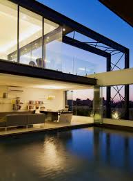 contemporary architecture featuring glass walls and artistic