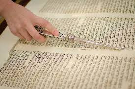 torah yad a girl reads from the torah using a pointer or yad