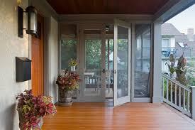 retractable screen door porch traditional with front door three