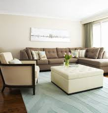 living room layered in differend shades of beige wall clocks white