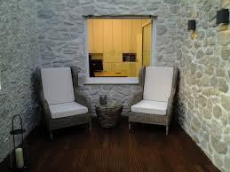 steinwand wohnzimmer beige haus renovierung mit modernem innenarchitektur kühles steinwand