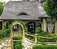 what the heck is a fairytale cottage anyway once upon a time and that fence with its stone base ironwork and wood detail is really icing on the cake i see no others like it in carmel
