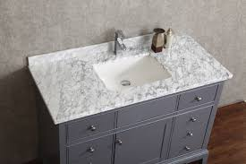 gray bathroom vanity with different size city gate beach road