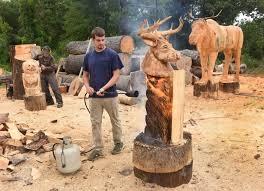a craving for carving athol wood artists turn trash into treasure