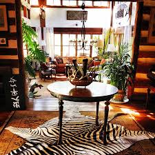 stunning cowhide zebra rugs pillows from forsyth view in gallery zebra hide rug gives the room an instant focal point