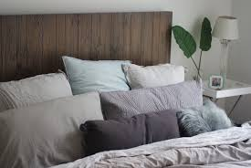 grey and silver linen bed with too many pillows leo with cancer