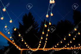at a wedding reception lights are hung in strands to create a
