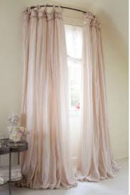 Decorative Rods For Curtains Use A Curved Shower Curtain Rod To Make A Window Look Bigger 15
