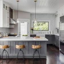 Gray Kitchen Island Gray Kitchen Features Gray Shaker Cabinets Adorned With Brass