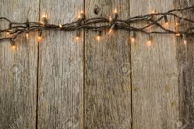 rustic wood whiite tree lights with rustic wood background stock