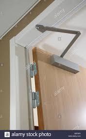Overhead Door Hinges Up Of A Modern Hotel Door Showing Sprung Overhead Door