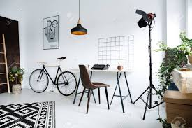 home workspace simple white home workspace with desk l chair bike plants