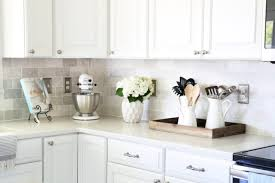 how to lay tile backsplash in kitchen how to install a marble subway tile backsplash just a and