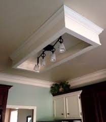 Kitchen Lighting Fluorescent Changing Fluorescent Light Box To Track Lighting And Added Molding