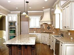 white kitchen cabinets black countertops backsplash designs