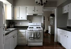 gray kitchen cabinets white appliances how to afford a kitchen remodel