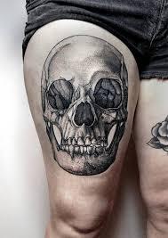 black ink skull on right thigh