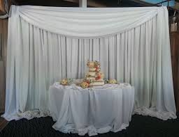 wedding backdrop drapes draped backdrop for wedding cake table arrowhead dj events