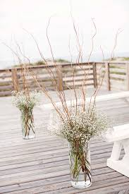 curly willow centerpieces curly willow and baby s breath ceremony arrangements wedding
