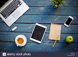 group of modern business gadgets and objects on wooden table stock