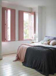 pink solid panel shutters give this pretty bedroom design a pink solid panel shutters give this pretty bedroom design a restful feel http
