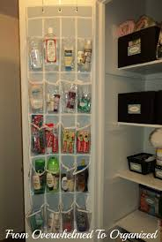 organized linen closet clear over the door shoe organizer