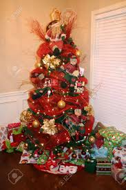 tree decorated with and gold ornaments stock photo