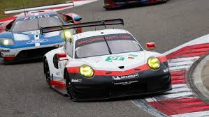porsche racing colors porsche claims world championship titles after hard fight in shanghai