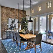 accent brick wall dining room traditional with pendant light