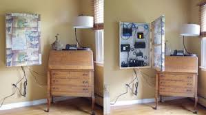 how to organize wires behind desk how to hide wires and routers behind a framed panel