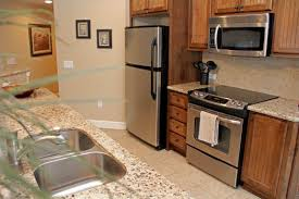 wooden kitchen looks soft with stainless steel appliances