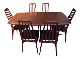 mid century danish dining table and six matching eva chairs by