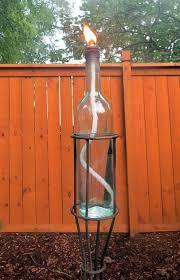 diy u2013 bottle tiki torches u2013 wine bottle in stand u2013 bellinis on