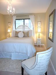 decorating small guest bedroom design with nice sofa and queen bed