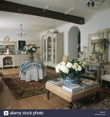 vase of white hydrangeas on upholstered stool in country living