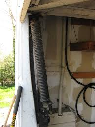 replace spring on garage door garage door maintenance garage door repair experts door