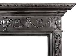 a 19th century polished cast fireplace mantel in adam
