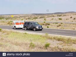 suv towing u haul trailer i 10 southeast arizona driver visible