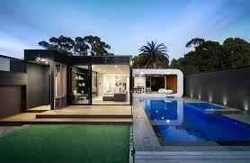 nice patio with cabinet also black chairs beside of big pool house