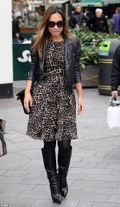 myleene klass stuns in cinched leopard print dress and biker