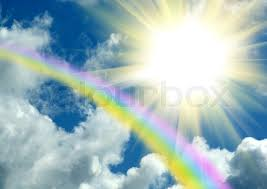 rainbow and the sun in clouds in the blue sky stock photo