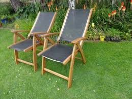 solid teak 2 large reclining garden chairs by