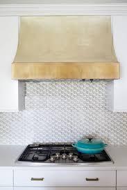 kitchen brass vent hoods with smart tile backsplash also